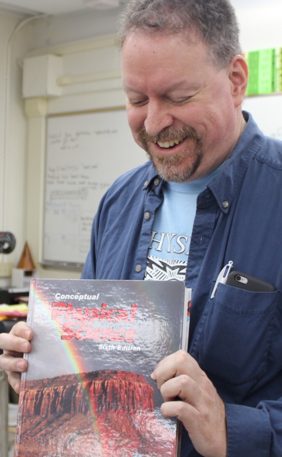 Teacher's photos printed in textbook