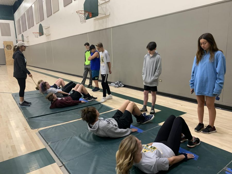 0 Period PE 1 students practice the curl-ups area of the Calif. standardized fitness testing. Usually the official test is conducted in May.
