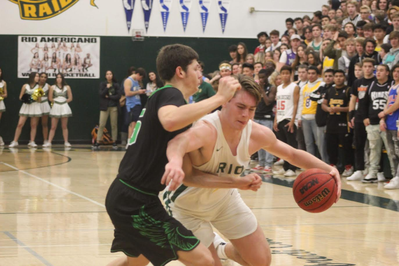 Mitchell Dixon protects the ball against an El Camino player