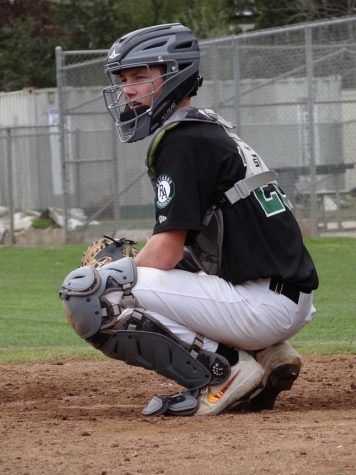 Senior Nolan Barry plays catcher for the Varsity boys baseball team, and hopes to compete in college.