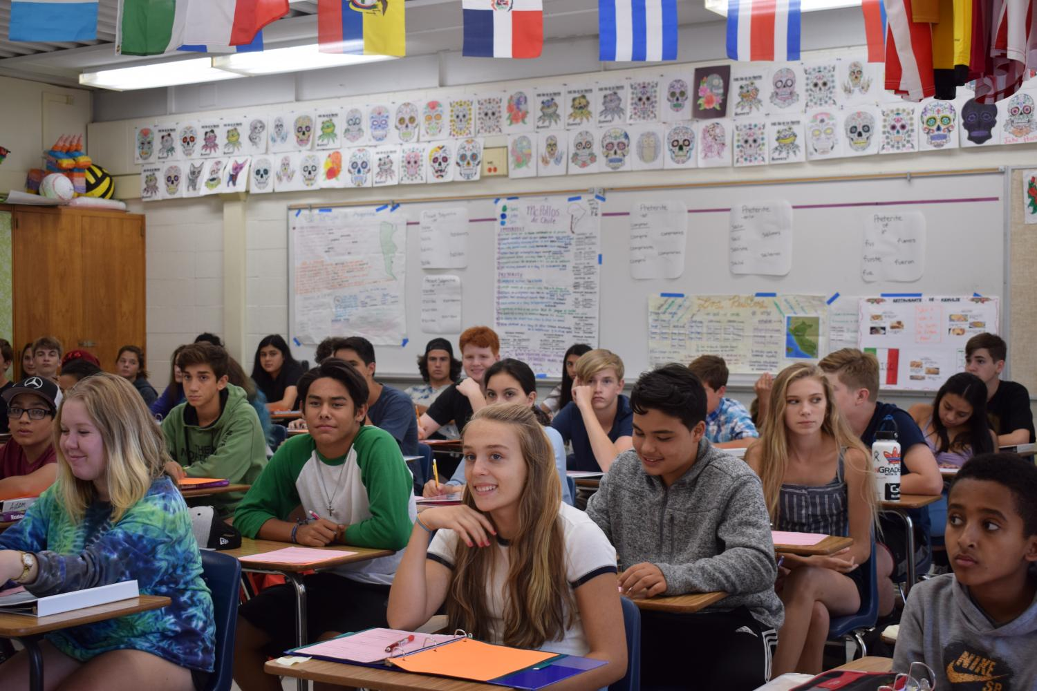 Students struggle to find seating in Brian Asher's Spanish class.