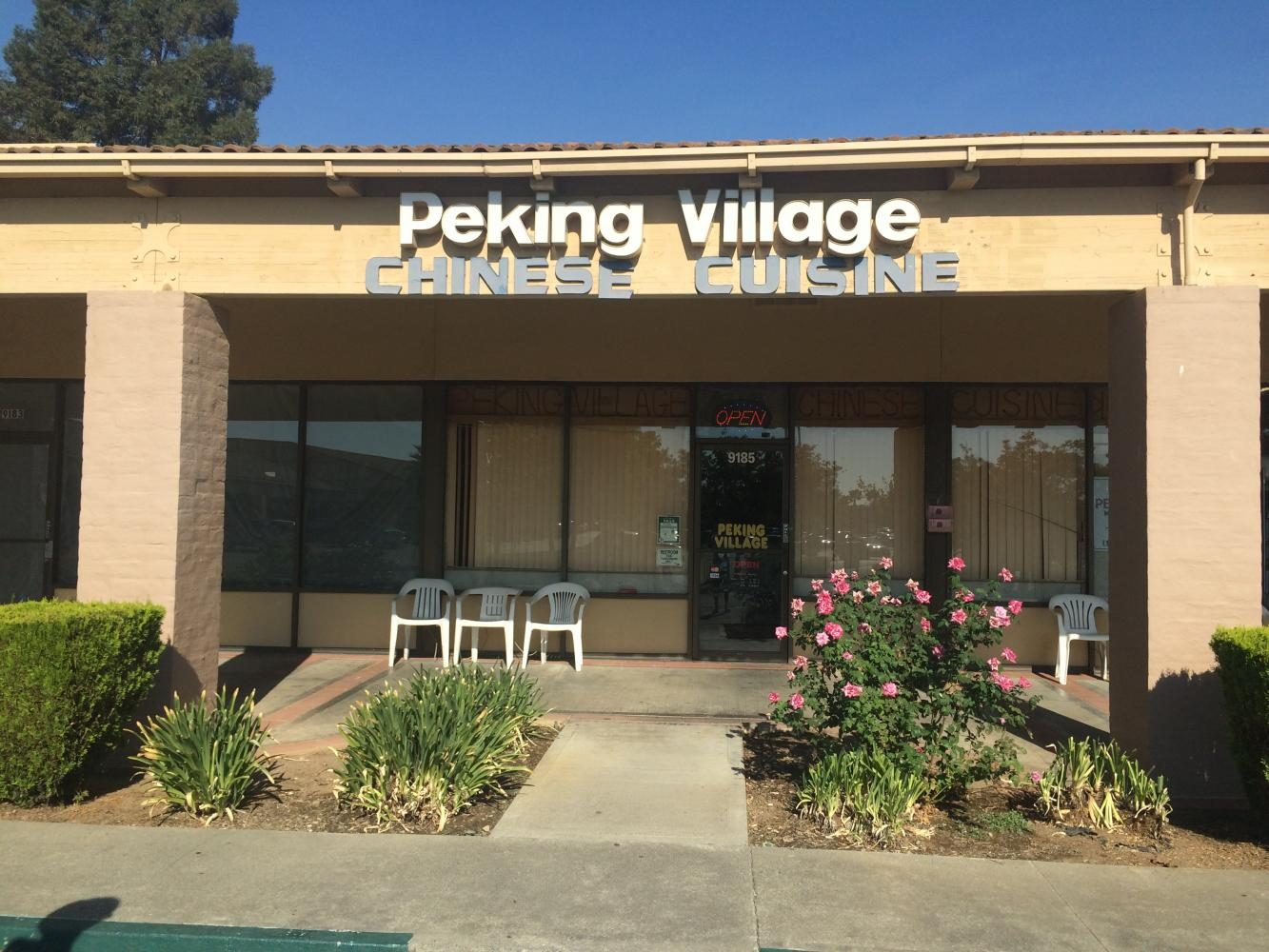 Peking+Village+is+tucked+away+behind+the+plaza.