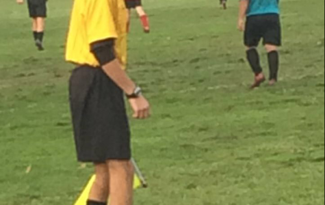 Junior referee keeps players in line
