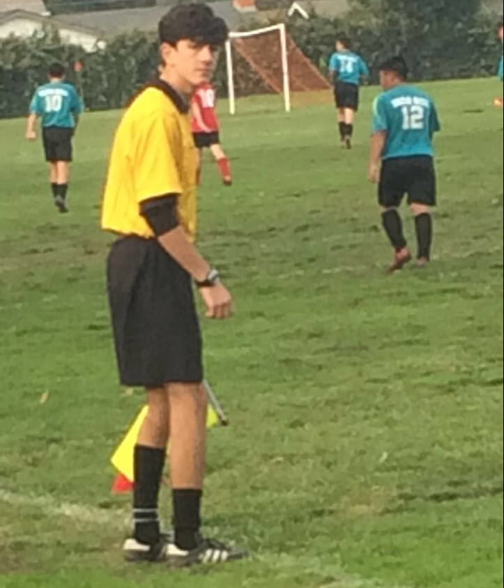 Junior Pasquale De Luca refereeing boys soccer on Nov. 18.