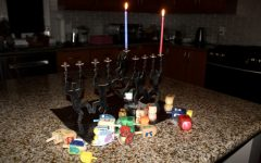 Rather than large family gatherings, many Hanukkah celebrations this year  consist only of members of the same household. However, many customs persist, such as the lighting of the menorah and the playing of dreidel games.