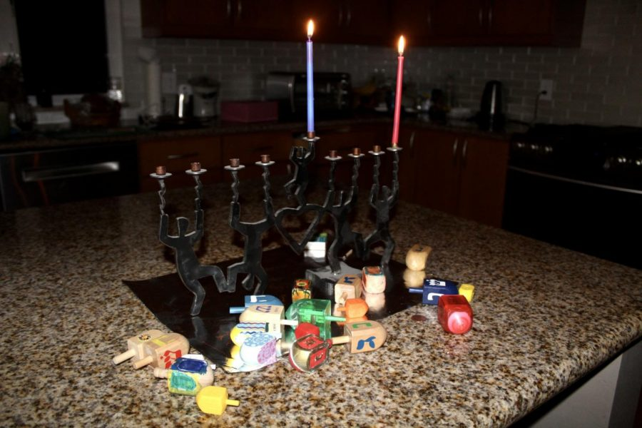 Rather+than+large+family+gatherings%2C+many+Hanukkah+celebrations+this+year++consist+only+of+members+of+the+same+household.+However%2C+many+customs+persist%2C+such+as+the+lighting+of+the+menorah+and+the+playing+of+dreidel+games.+