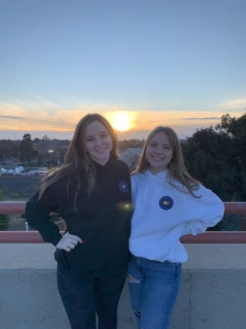 "Lehrer and Halloran pose in their ""Feel the Love"" sweatshirts to promote their project. All of their merchandise was designed by Rio graduates Jane Snider and Chase Iseley."