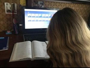 During the third week of school, freshman Samantha Courtade takes notes on The Odyssey from her English book as she logs into the San Juan Portal, where she will be able to turn in her work virtually.