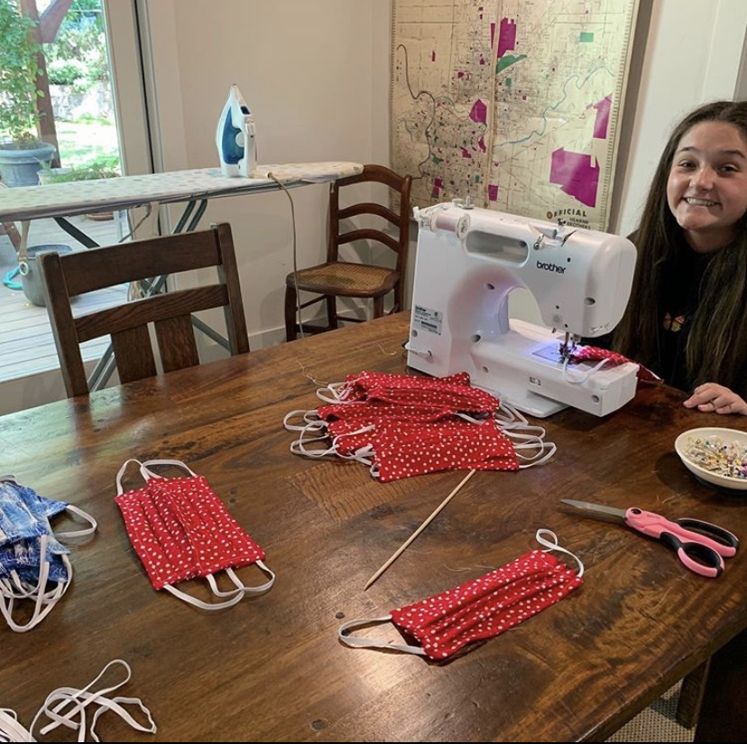 Davis works on sewing masks at her home to promote safety during the COVID-19 pandemic.