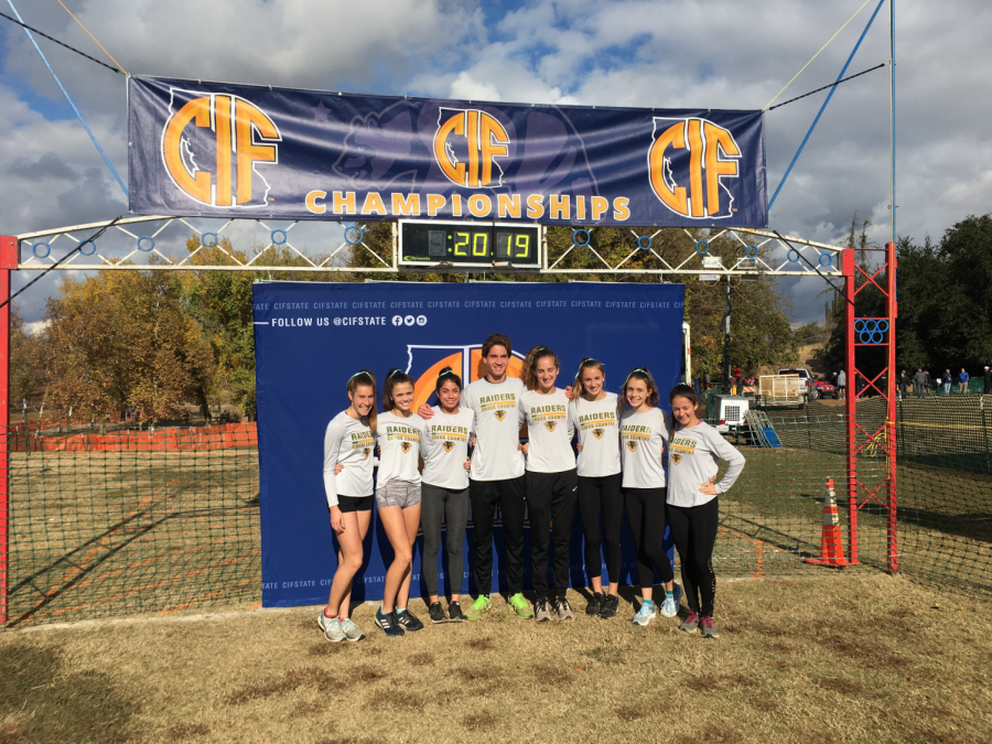 [left to right] Katie Newton, Lucy Prieto, Alyssa Escay, Nicolas Gorman, Annalee Gorman, Olivia Schlieman, Kaylee Barnes, and Ava Cardwell pose at the Calif. Cross Country State Championship Meet.