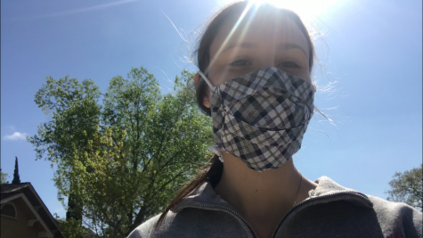 Senior Samantha Klein wears a mask on one of her walks outside, enjoying the fresh air.