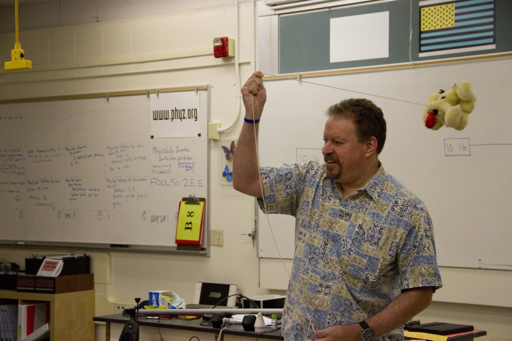 Baird+demonstrating+inertia+and+momentum+for+his+AP+Physics+class.+Baird+is+only+the+25th+California+teacher+to+receive+the+PAEMST++