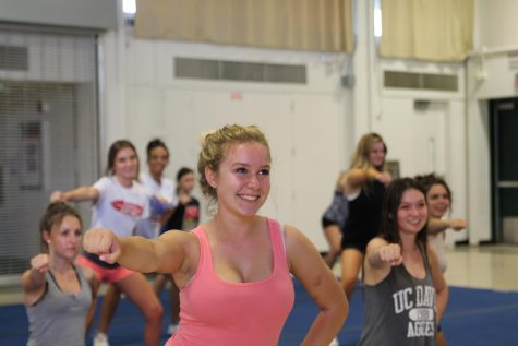 Dadigan leads a cheer practice Tuesday night.