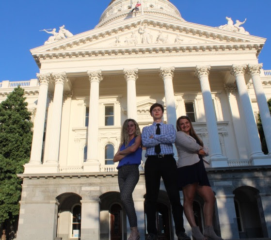 Civitas seniors (from left to right) Samantha Ford, Jacob Osecheck, and Carolyn Lidster posing in front of the state capitol.