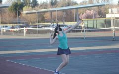 Senior Emma Chally works on her serve during practice at Rio early in the season. Chally was one of four graduating seniors playing on the team this year and will attend University of California in Santa Barbara in the fall.