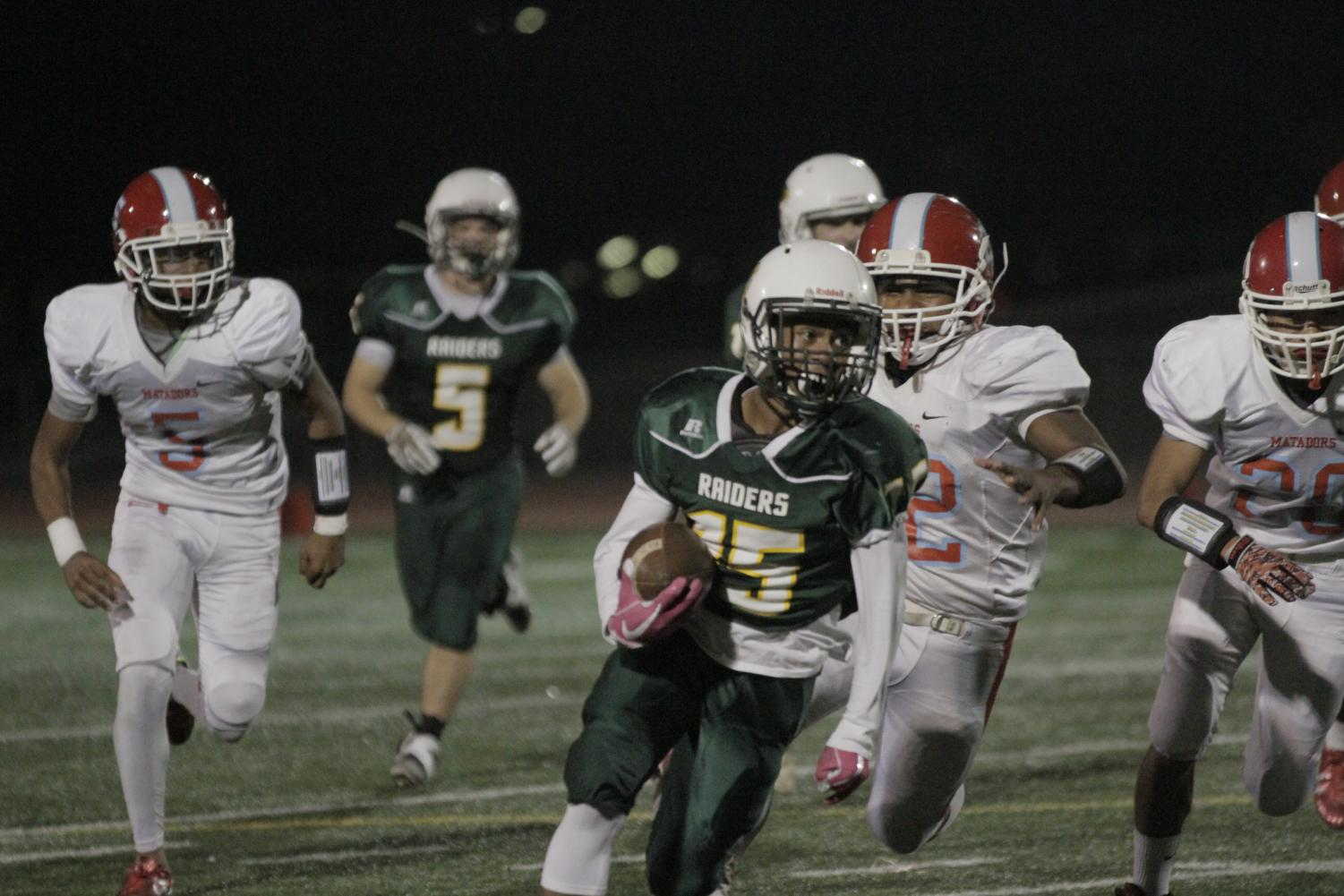 Sophomore Savion Ponce carries the football in a game against Mira Loma on Oct. 27.