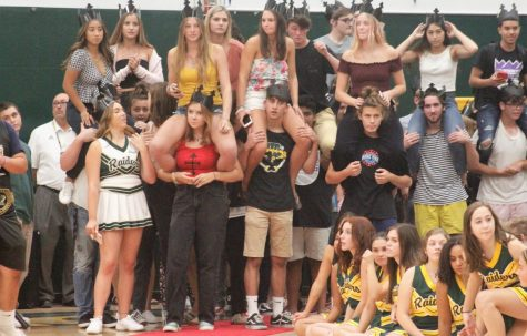 Seniors eargerly await finally walking down the ceremonial red carpet into their last back-to-school rally.