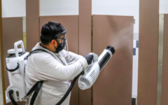 A worker sanitizes a restroom at Mira Loma High School in a photo that was included in the slide presentation shown to the school board on Oct. 13. Enhanced cleanings would be part of bringing students back on campus part-time.