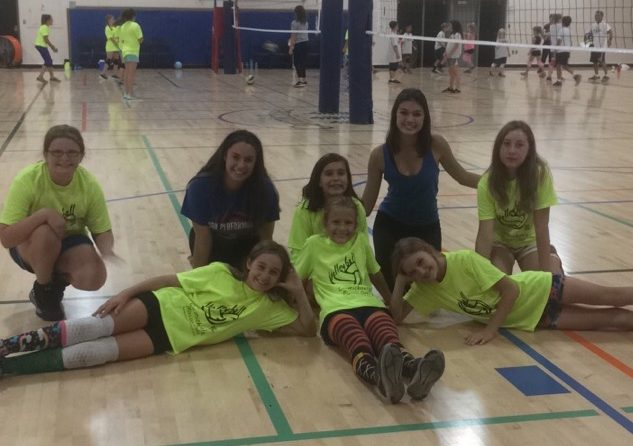 Sophomores Gia Greenmore and Stella Chamness dedicate their time to helping coach young girls.