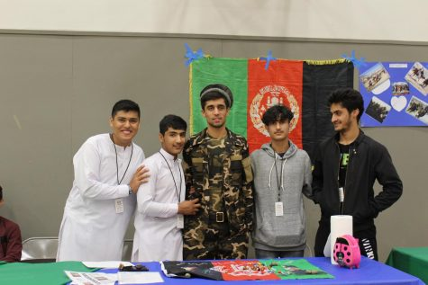 Hedayat Ebrahim Khel and friends teach other students about their culture at the Global Expo on campus last fall.