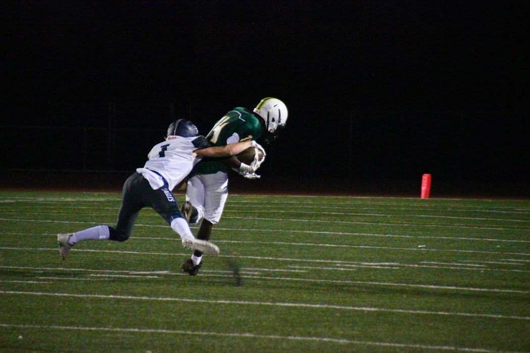 Jalen Taylor gets tackled after a long run.  Photo by Jane Snider.