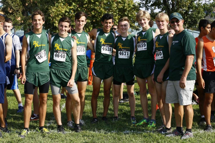 Former coach Gordon Hubble with varsity runners Nicolas Gorman, Ross Gowan, Jack Pallasen, Chase Gordon, Jensen Salvatori, Reed Moore, and Jack Murphy