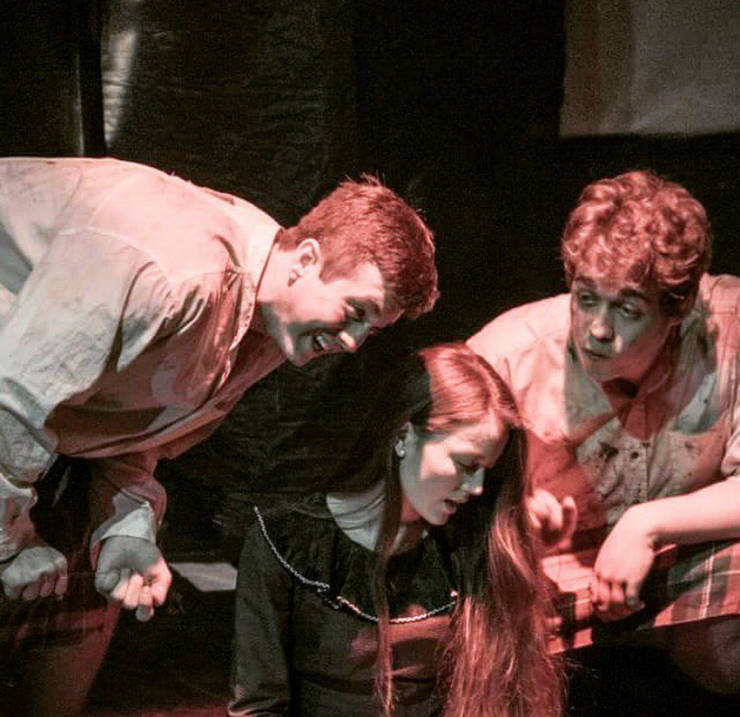 Mayla McArdle (center) portrays Mother Road in Tar and Feathers with senior Josh Davis (left) and alumnus Mitchell Worrell-Olsen (right).