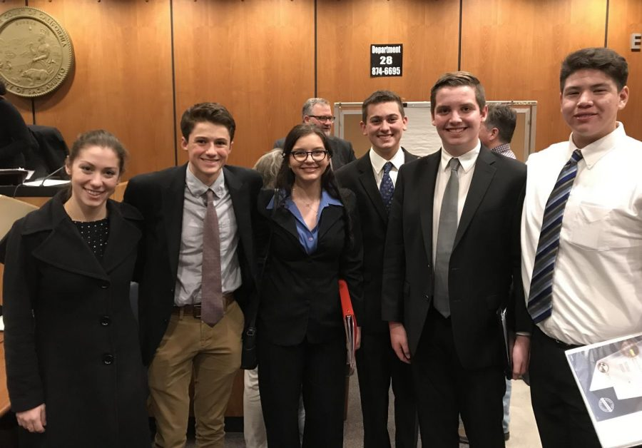 Moot Court team members Hudson Burke, Emma Phoenix, Kabir Tagore, Ben Davis, and Alec Sumner with coach after competition.
