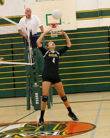 Reaching for the ball Lauren Mclane prepares to set against  Oakmont ending in a 3-2 win.