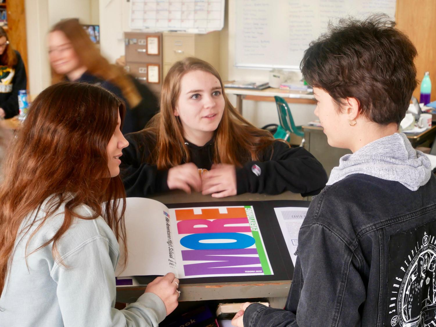 Yearbook editors Liz Gore, Riley Stoddard and Justine Waters proof the cover for this year